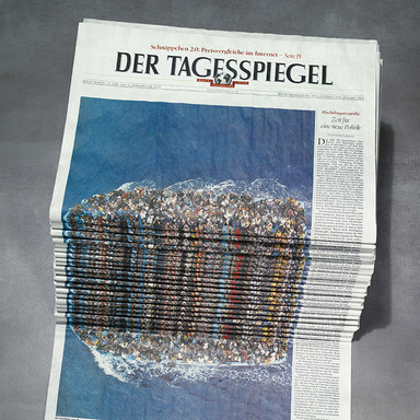 Newspaper Stack - Refugees